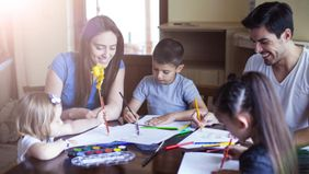 Family drawing together after receiving child tax credit payment