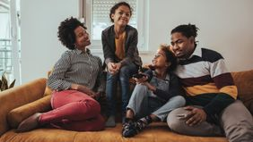 family on couch saving money