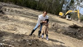 Jackie Jimenez and her daughter, Layla, on their lot.