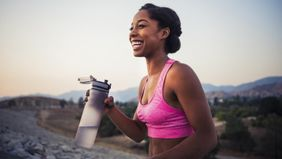 woman with water bottle pursuing wellness goals