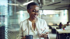 Businesswoman reading Northwestern Mutual Marketing Commentary