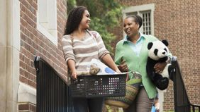 mom helping daughter move into dorm