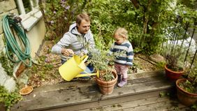 October-2021-Buy-skip-father-daughter-watering-plant