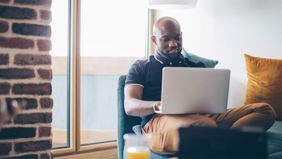 Man on laptop looking at his investment portfoilo