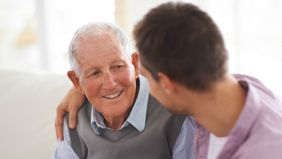 Father and son determining long-term care should be part of financial plan