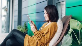 Woman looking up a smart investing strategy
