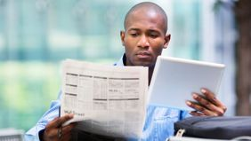 Man looking at the difference between stocks and bonds