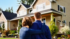 How to buy your dream home couple looking at a house