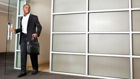 Man leaving his job after quitting the right way