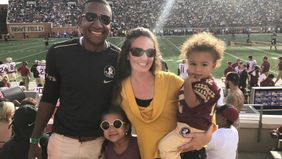 Financial planner and his family at BB&T Field