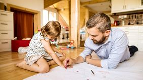 dad and daughter brainstorming home design
