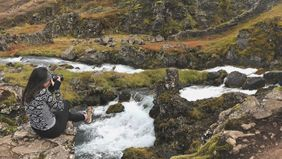 Carrie D'Agostino, founder of Wren & Fable, conducting a photoshoot in Iceland