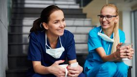 Two female surgeons taking a coffee break