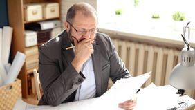 A middle-age reviews his finances