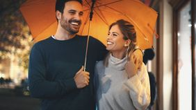 Couple walking on a rainy night discussing how do variable annuities work.