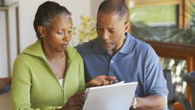 Couple discussing the different types of annuities.