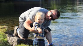 Franklin Antoian and his son at the lake