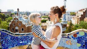 mom and daughter on vacation at Park Güel in Barcelona, Spain