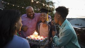 Family celebrating a high school graduation.