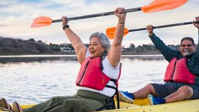 senior couple kayaking in retirement