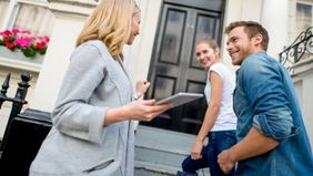 Young couple meeting home inspector.