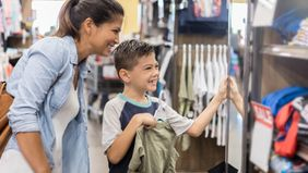 Mother and son shopping for back-to-school clothes.