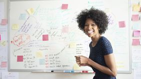 woman standing in front of a white board