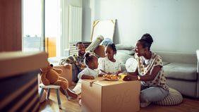 Family unpacking who bought a home out of state