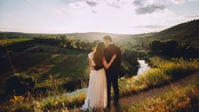 newlywed couple looking out at view