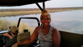 Tasha Danielle riding a Jeep during a tour in South Africa.
