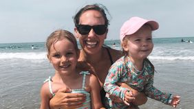 Kristin Bartlow and her daughters on the beach