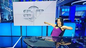 Victoria Arlen sitting at ESPN news desk