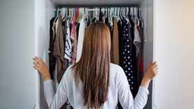 Woman looking in closet