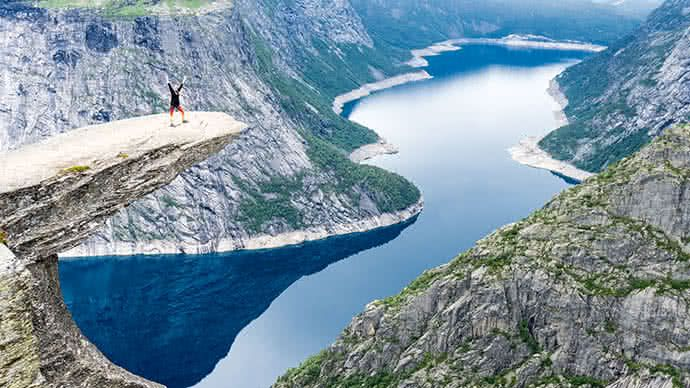 Canfield McNish hikes the Trolltunga cliff in Norway.