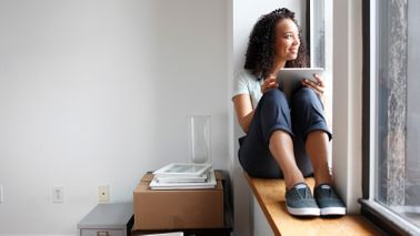 Woman in apartment wondering how much she should spend on rent