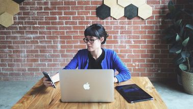 Woman at desk budgeting for business startup costs