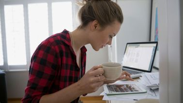 Woman researching the benefits of saving early and compound interest