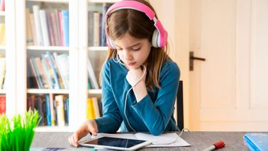 Young girl doing online learning through educational websites and apps for kids