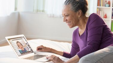 Grandmother staying connected with grandson over video conferencing while social distancing.