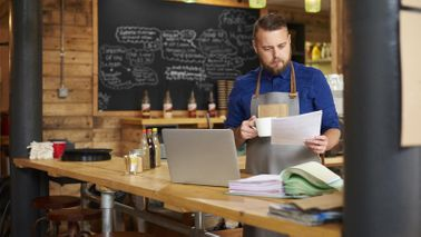 Small business owner reviewing Paycheck Protection Program