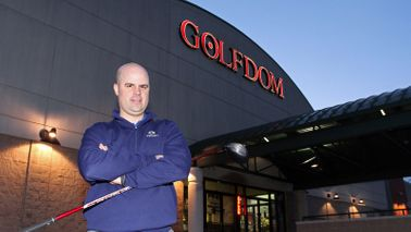 Buddy Christensen in front of golf retailer Golfdom