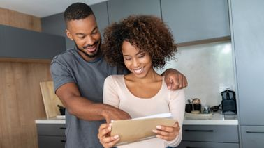 couple at home reading through their health care options