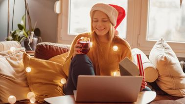 Woman enjoying virtual office party with gifts