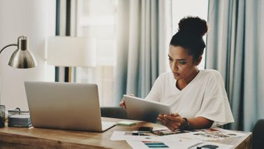 woman overworking from home office