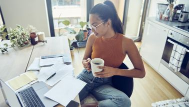 woman at home desk filing taxes early