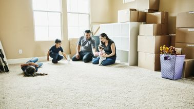 Family moving into a bigger home