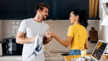 couple doing dishes together