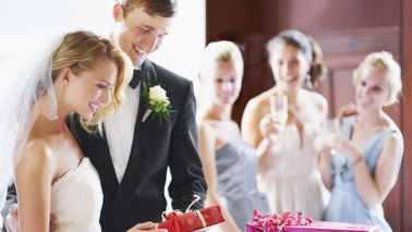 couple opening gifts from wedding registry