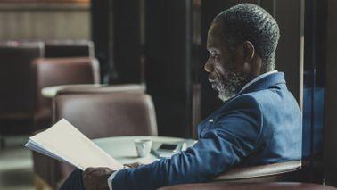 Man reading Northwestern Mutual Market Commentary