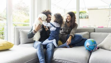 parents and child having fun in living room